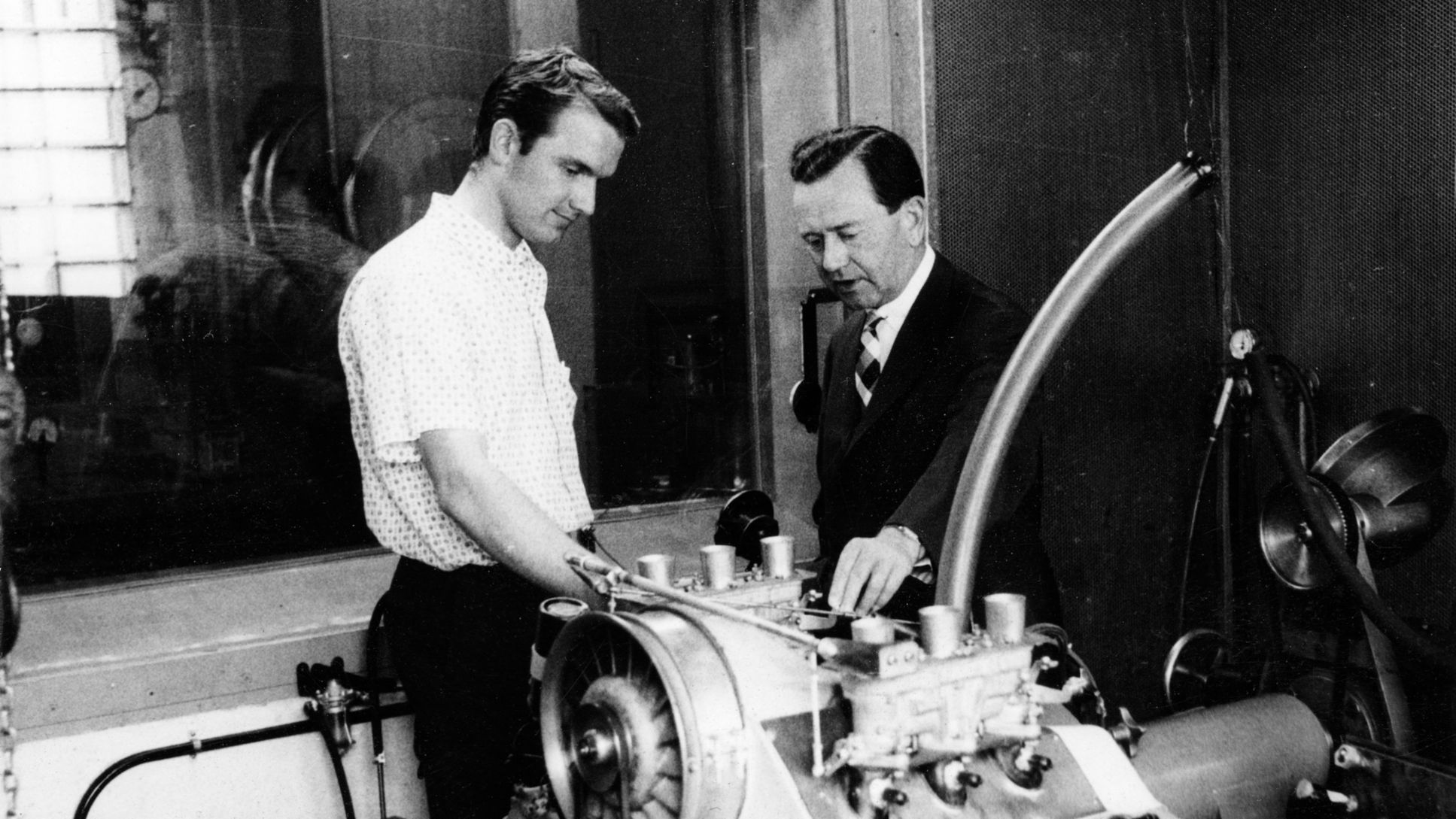 Ferdinand Piëch (left) and Ferry Porsche next to the engine of the Type 718/2 of the Porsche 901, approx. 1963, Porsche AG