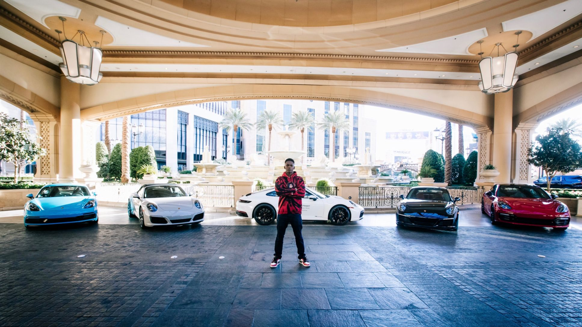 UFC champion Israel Adesanya with a select Porsche Passport fleet offering, Las Vegas, 2020, Porsche AG