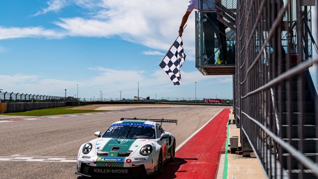 Porsche Carrera Cup North America Presented by the Cayman Islands - Kay van Berlo (Netherlands) takes the Race 2 checkered flag at COTA, 911 GT3 Cup, 2021, PCNA