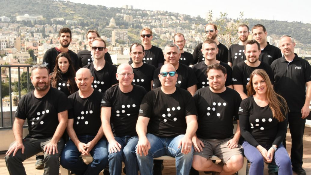 1st Row, Third from Left, Left to Right: CEO Amit Nisenbaum, VP Business Development Eitan Grosbard, and Founder/CTO Boaz Mizrachi, 2019, Porsche AG