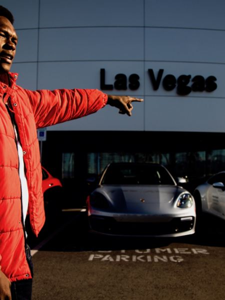 UFC champion Israel Adesanya surveys the lot and available Porsche Passport fleet at Gaudin Porsche, Las Vegas, 2020, Porsche AG
