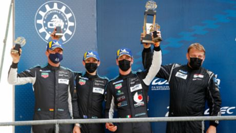 Matt Campbell on the Le Mans podium for Porsche customer team Dempsey-Proton Racing