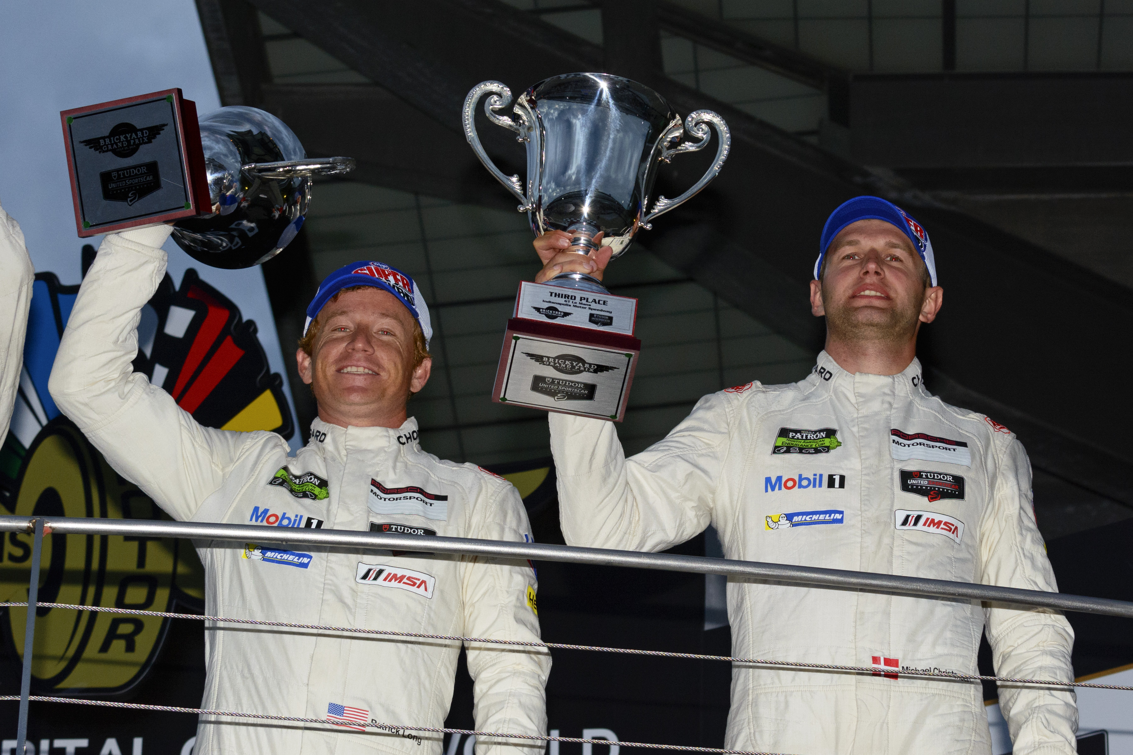 Patrick Long and Michael Christensen celebrate IMSA Podium at Indy in 2014, PCNA