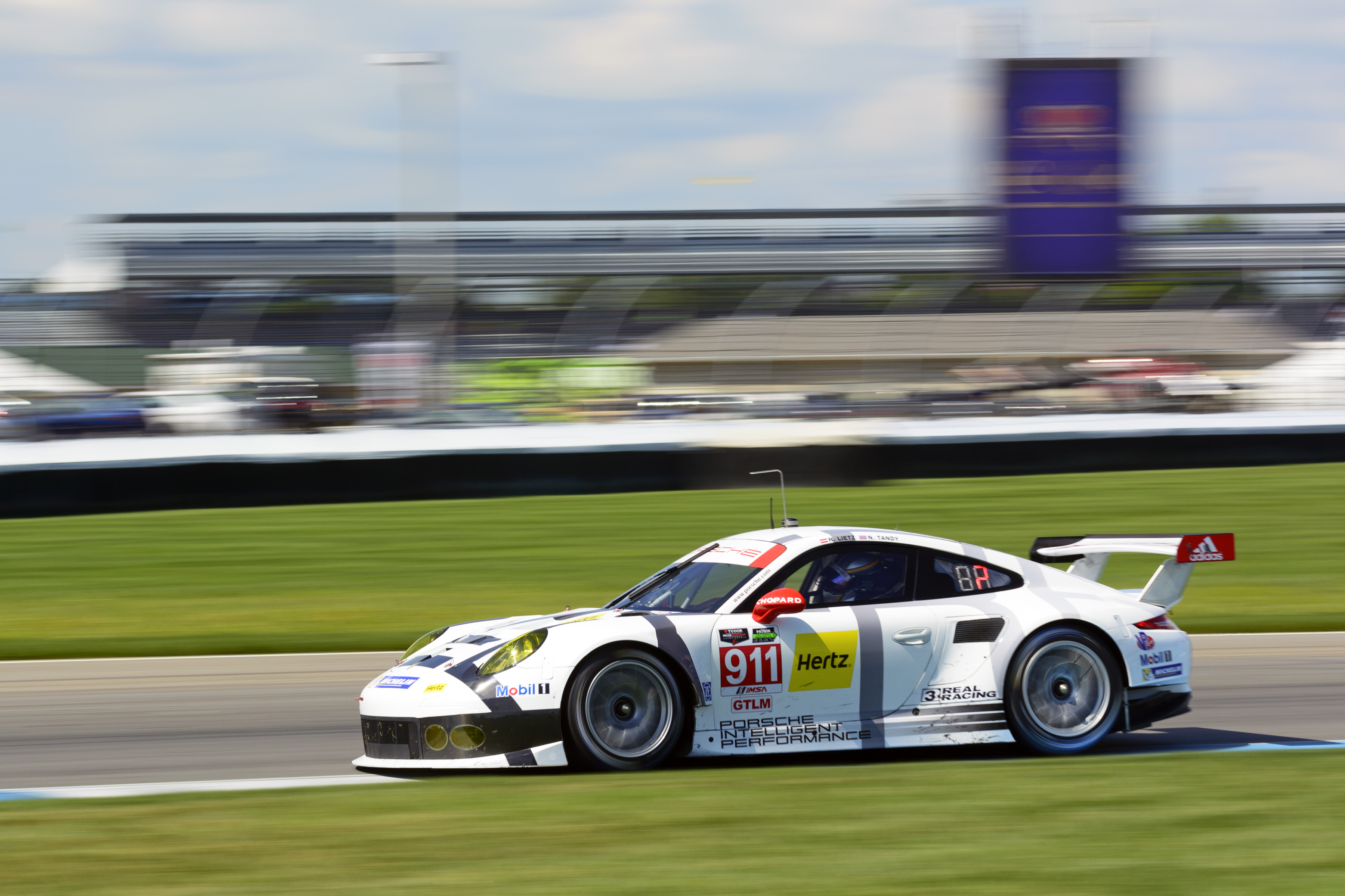 Nick Tandy pilots the No. 911 Porsche North America Porsche 911 RSR through the Indy infield, PCNA