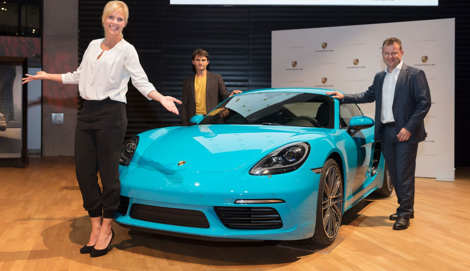 Melanie Marschke, Actress, Lenn Kudrjawizki, Actor, Gerd Rupp, Chair of the Executive Board at Porsche Leipzig, l-r, 718 Cayman, 2017, Porsche AG