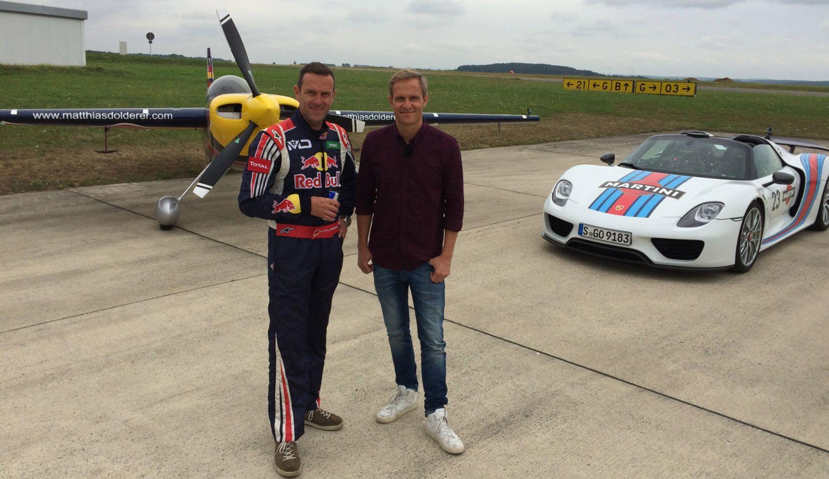 (l.-r.) Matthias Dolderer, air race pilot, Matthias Malmedie, GRIP test driver, 918 Spyder, racing aircraft Zivko Edge 540 V3, airport Zweibrücken, 2016, Porsche AG