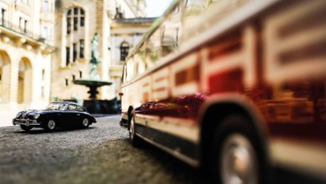 The illusionary giants: Model cars set in scene
