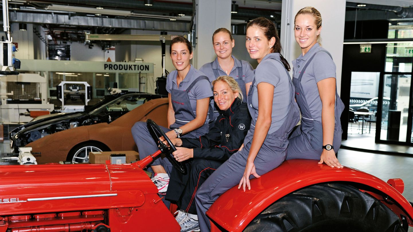 Andrea Petkovic with fellow players on the legendary Porsche tractor (2011)